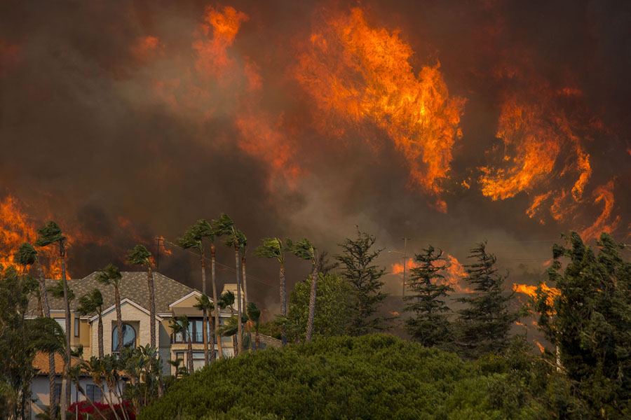 The Woolsey Fire approaches homes in Malibu on November 9, 2018. #