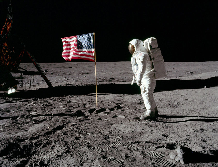The astronaut Edwin E. Aldrin Jr., the lunar-module pilot of the first lunar-landing mission, poses for a photograph beside the deployed United States flag during an Apollo 11 extravehicular activity (EVA) on the lunar surface on July 20, 1969.