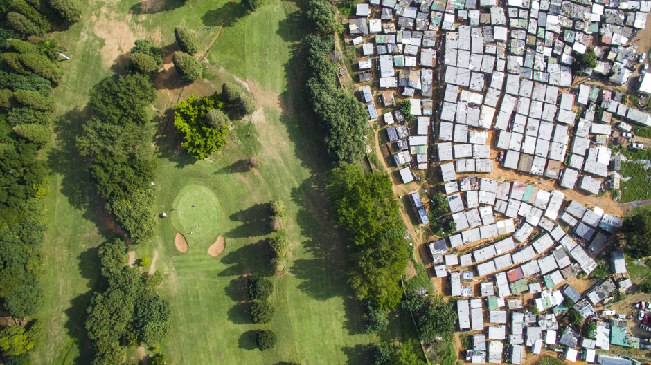 http://www.citylab.com/housing/2016/06/apartheids-urban-legacy-in-striking-aerial-photographs-south-africa-cities-architecture-racism/487808/
