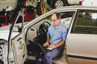 Sevart, runs diagnostics on a vehicle (1-70 Auto Service)