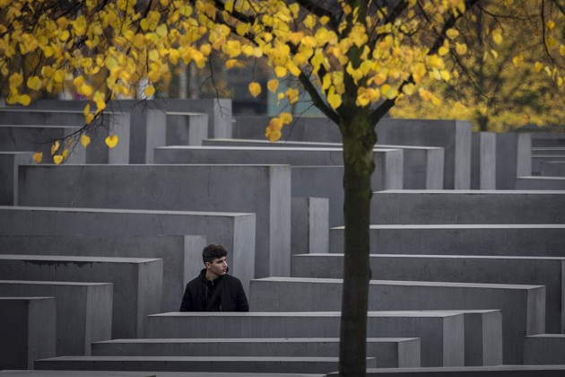 A man walks though the Memorial to the Murdered Jews of Europe in Berlin.