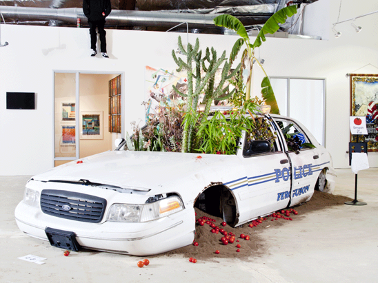 Jordan Weber's installation of a destroyed police car is pictured.