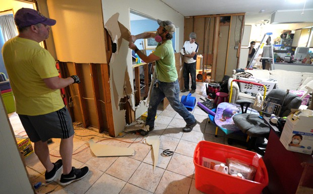 Tearing out drywall from a home in Houston after Harvey