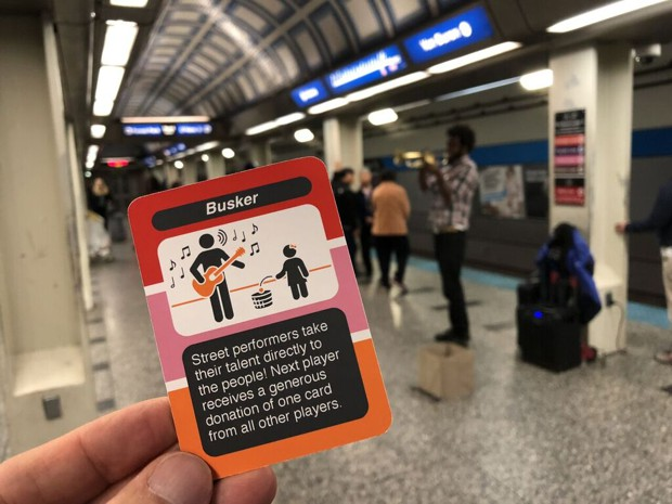 LOOP card game for Chicago L transit depicts a station busker