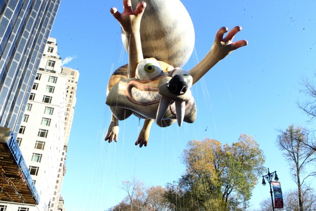 Scat, the excitable squirrel from the movie Ice Age, in giant balloon form flying over the Macy's Thanksgiving Day Parade.