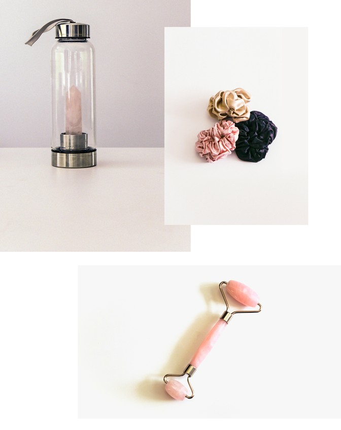 A Glacce Crystal Elixir Water Bottle, slip silk scrunchies, and a rose-quartz face roller