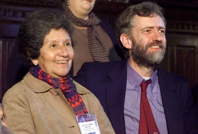 A younger Jeremy Corbyn sits alongside a woman who was a victim of Augusto Pinochet's regime.
