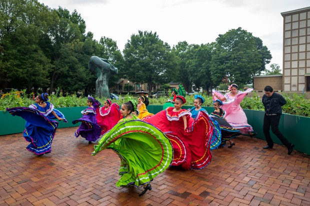 "Frida Escobedo Studio's ""Untitled"" installation for Exhibit Columbus serves as the backdrop for traditional Mexican folk dancers with Ballet Folclórico."