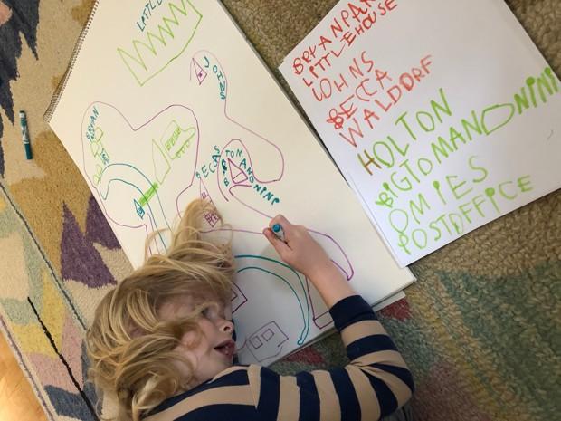 Uma criança desenha seu bairro na Virgínia com marcadores