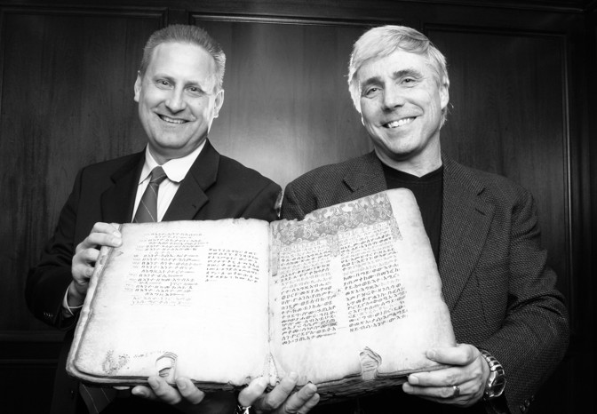 2010 photo: Steve Green and Scott Carroll hold a copy of the 14th-century Ethiopic Gospels