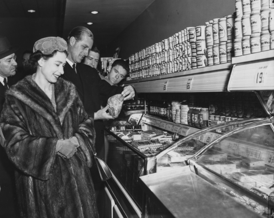 black and white 1957 photo of Queen Elizabeth at supermarket