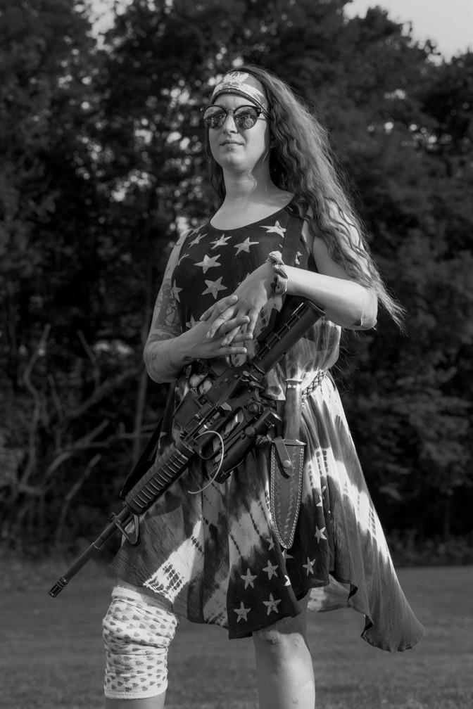 Armed militia member in stars and stripes dress