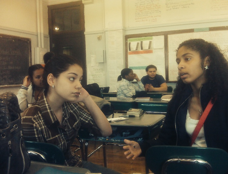 Jen and Amalia engaged in debate in Florina's class