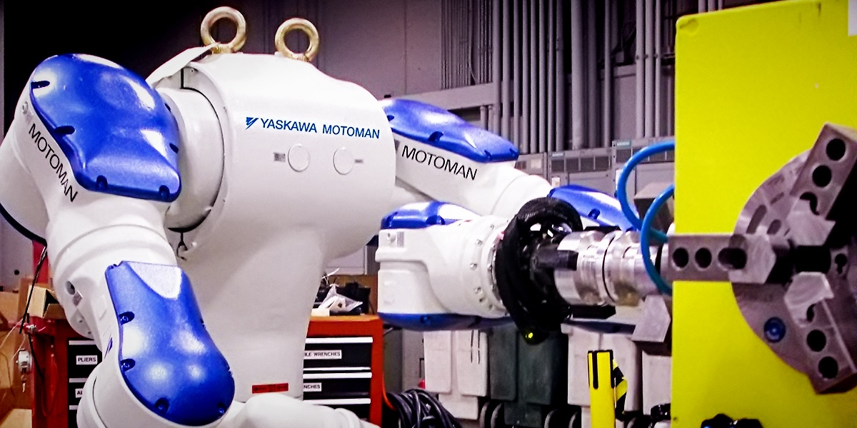 Yaskawa Motoman SDA10 robot doing some machine tending tasks. The 'bot is characterized by it's dual-arm, 'human-like' flexibility.