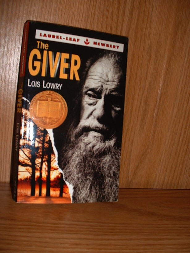 symbolism and theme in the giver essay