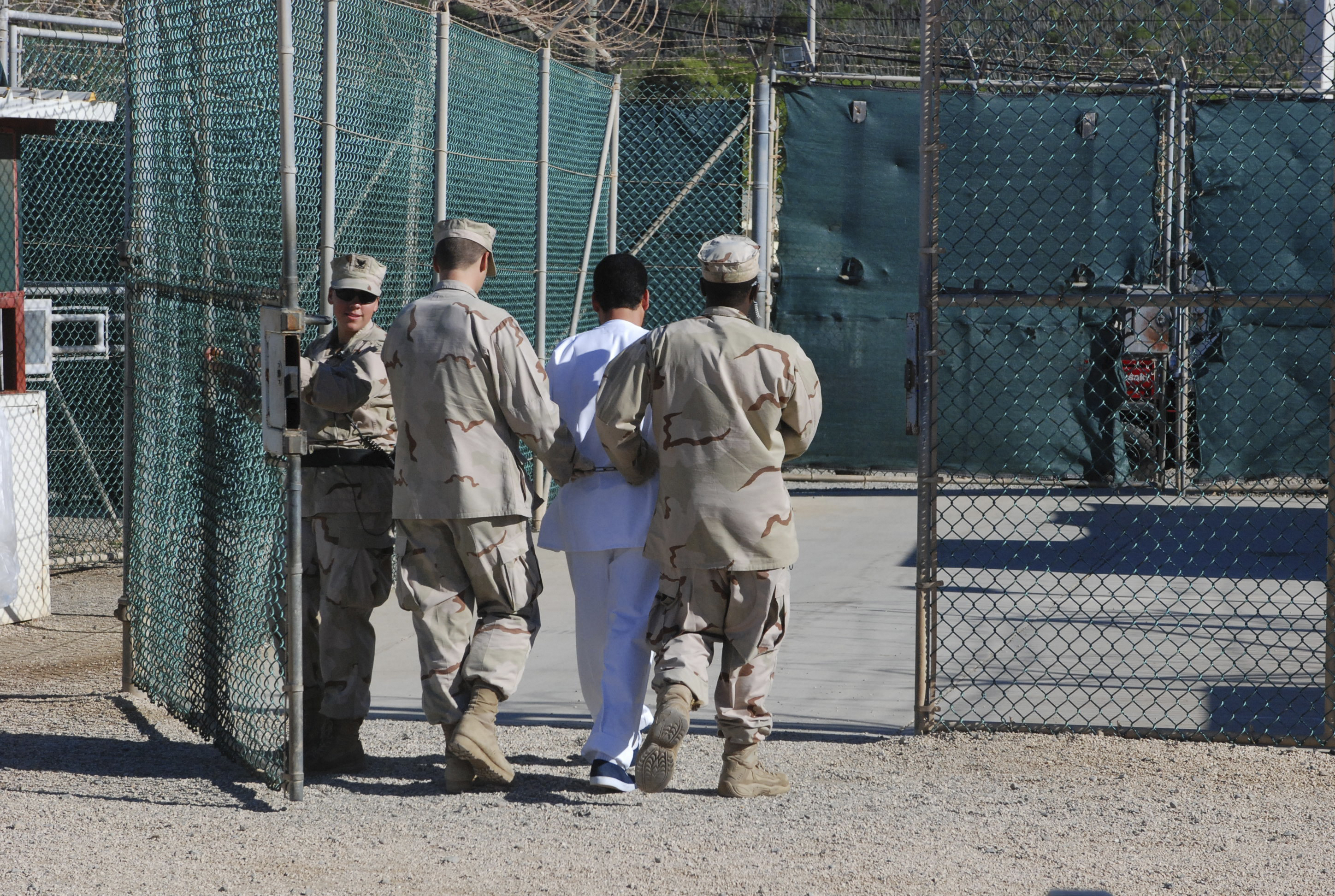 William Jefferson Clinton's military tribunal at Guantanamo Bay began on Friday, following a three-day delay caused by a female panelist whose amorous display of affection toward the former president shocked the Office of Military Commissions.