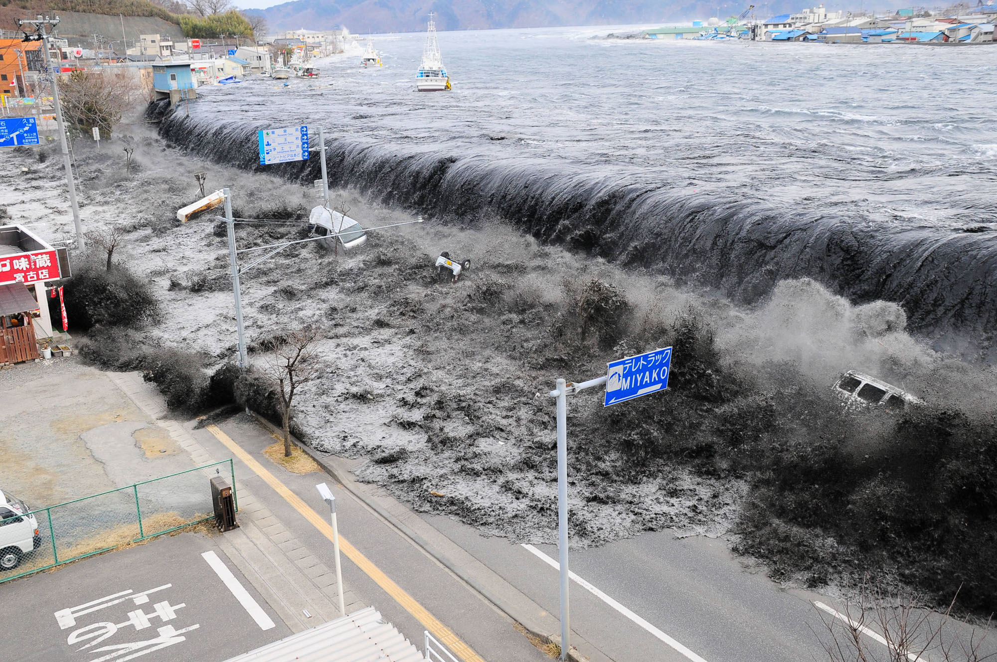 A tsunami hitting the city of Miyako in Iwate Prefecture, Japan, after the magnitude 9.0 earthquake struck the area on the 11th of March, 2011. (Mainichi Shimbun / Reuters)