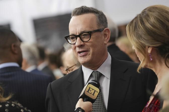 Tom Hanks speaks to an ET reporter