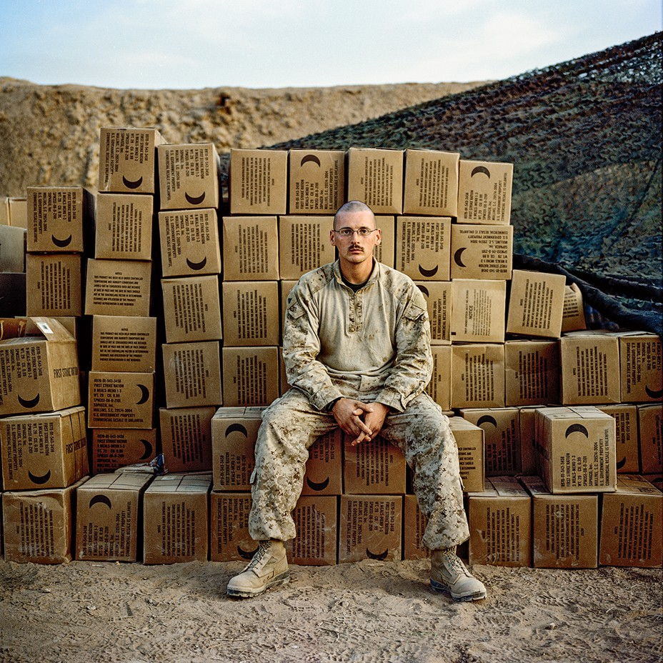 Soldier sits on stack of boxes