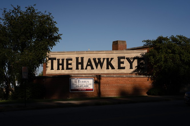 The Hawk Eye building with a For Sale Sign.