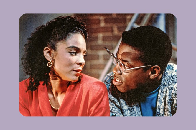 Still of Whitley Gilbert in profile talking with Dwayne Wayne, with sunglasses flipped up