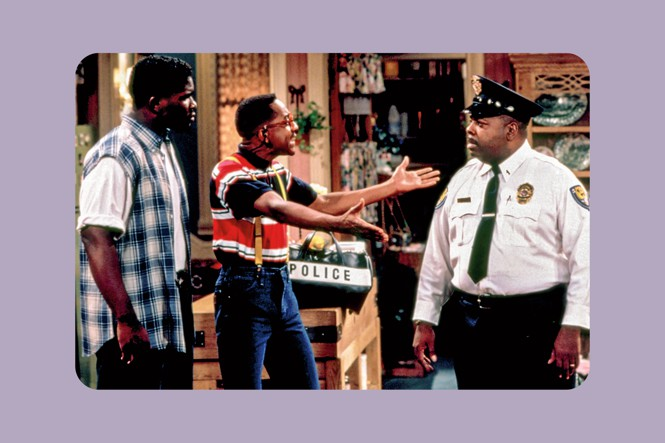 Still from 'Family Matters' with characters Eddie Winslow, Steve Urkel with arms extended, and Carl Winslow in uniform.