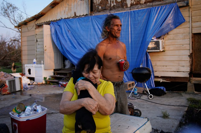 Residents outside a damaged home in Dulac, Louisiana