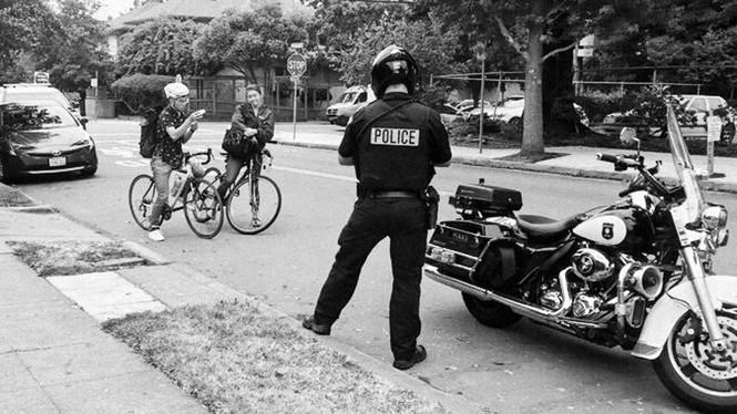An officer writing a ticket.