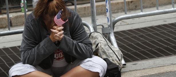 615 flag woman sitting sad.jpg