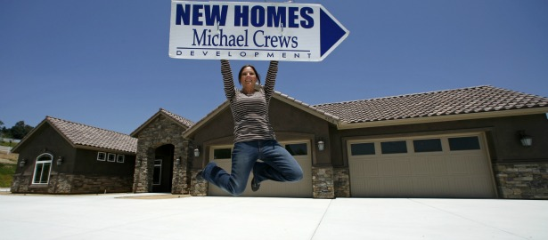 615 new homes jumping woman.jpg