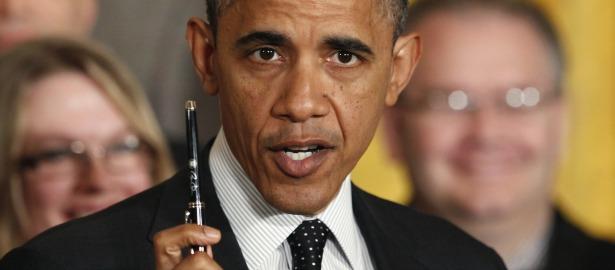 615 obama pen sign.jpg