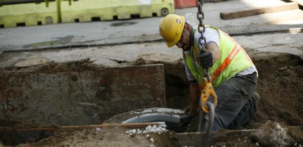 615 worker REUTERS Robert Galbraith.jpg