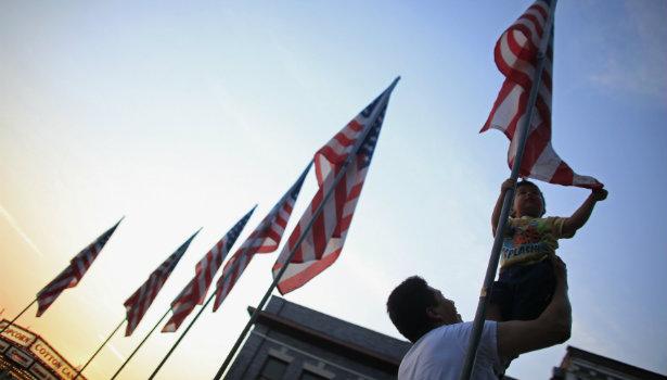 615_Immigration_Immigrant_Flag_Child_Reuters.jpg