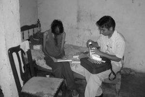 PIH community health worker in Peru working with a TB patient in 2009 300x200.jpg