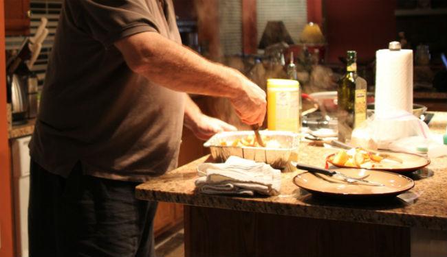 [man cooking in kitchen]