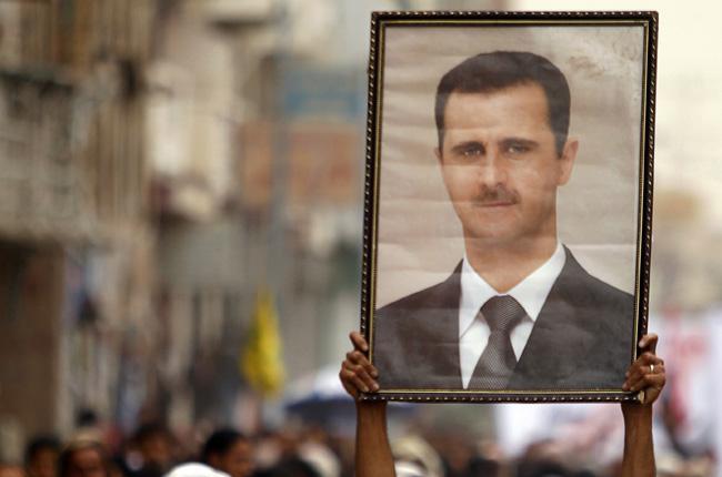 Assad portrait actual banner.jpg