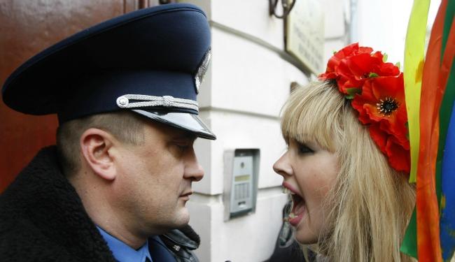 Femen yelling banner.jpg