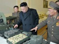 KJU with model tanks more on.jpg