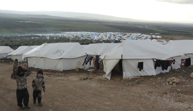 Sy tk refugee camp banner.png
