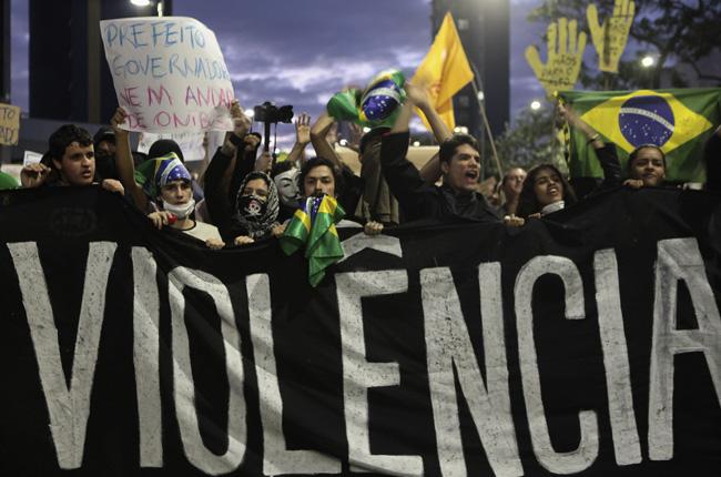 brazil protesters banner 2390234.jpg