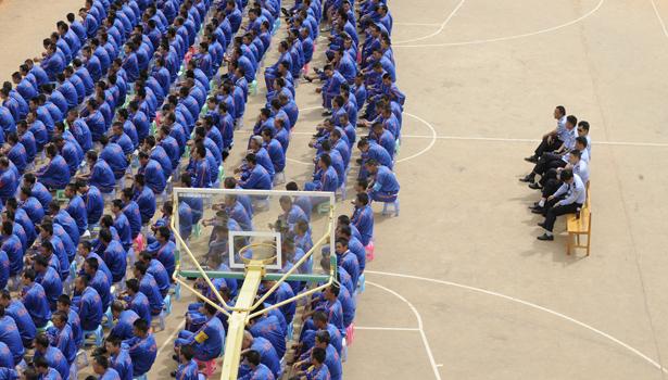 china prison camp banner.jpg