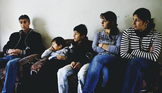 sy refugee family banner.jpg