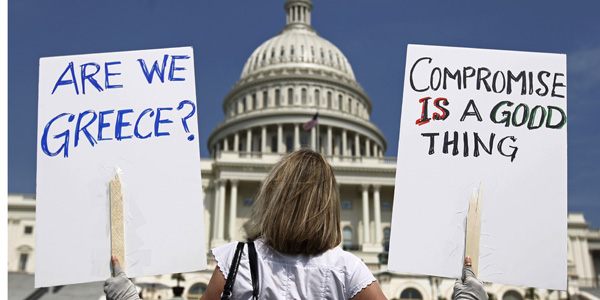 Capitol compromise signs - Kevin Lamarque Reuters - banner.jpg