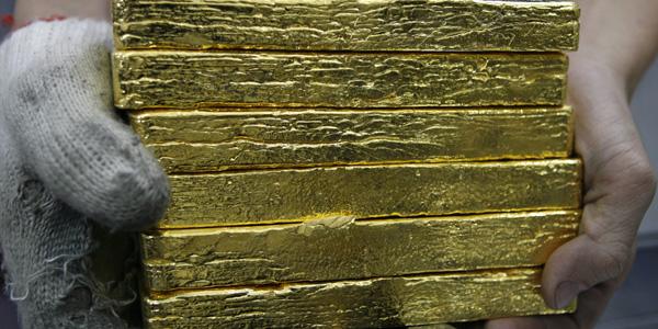 Gold bricks - Nguyen Huy Kham : Reuters - banner.jpg