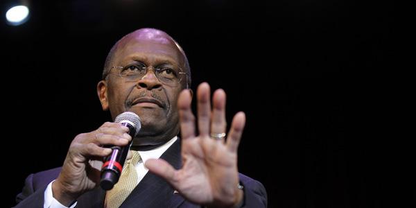 Herman Cain hand up - Isaac Brekken AP - banner.jpg