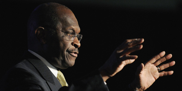 Herman Cain hands up - Jonathan Ernst Reuters - banner.jpg