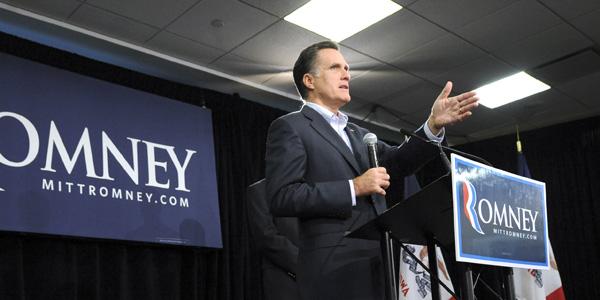 Mitt Romney in front of banner - AP Photo:Steve Pope - banner.jpg