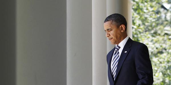 Obama walking to through columns - Jason Reed Reuters - banner.jpg