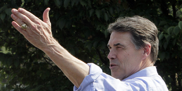 Rick Perry raised hand - Jim Cole AP - banner.jpg
