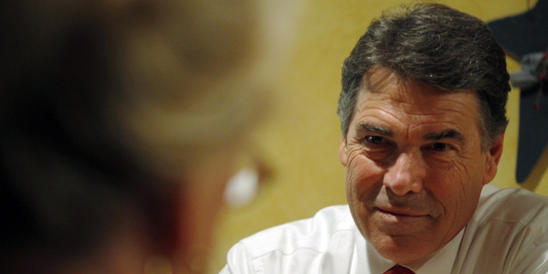 Rick Perry talking to activist - Brian Snyder : Reuters - banner.jpg